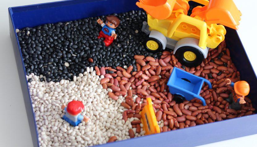 duplo and beans sensory bin