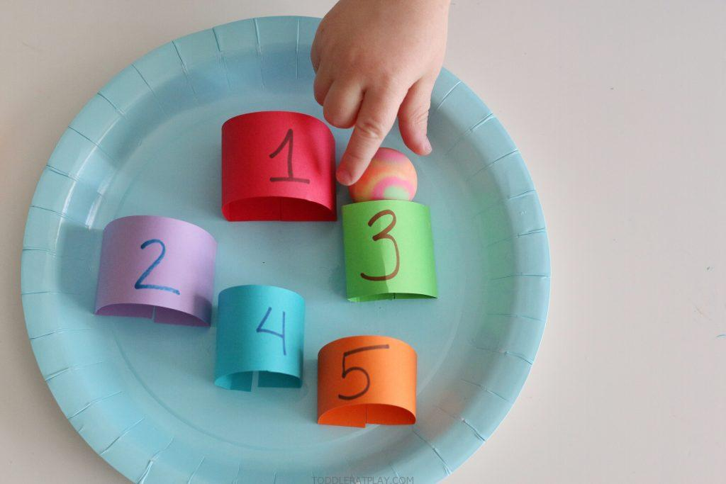 Paper Plate Marble Counting Maze- toddler at play (3)
