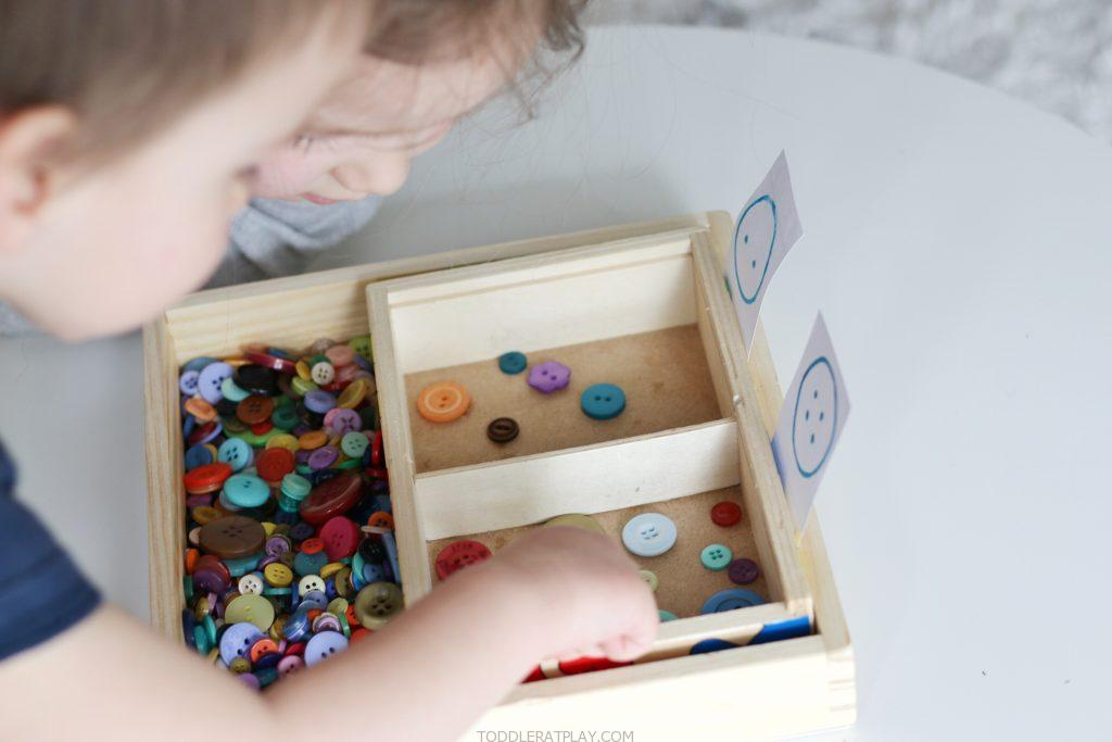 button sorting by the hole- toddler at play (1)