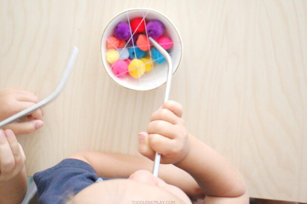 pom-pom straw pull- toddler at play (5)