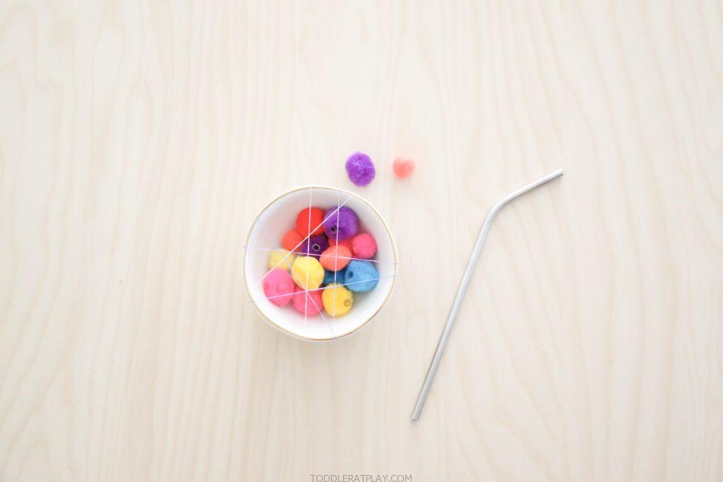pom-pom straw pull- toddler at play (3)