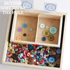 button sorting by the hole- toddler at play (4)