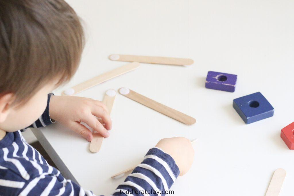 https://amzbuilding popsicle stick shapes activity- toddler at play (5)n.to/2Trs4PT